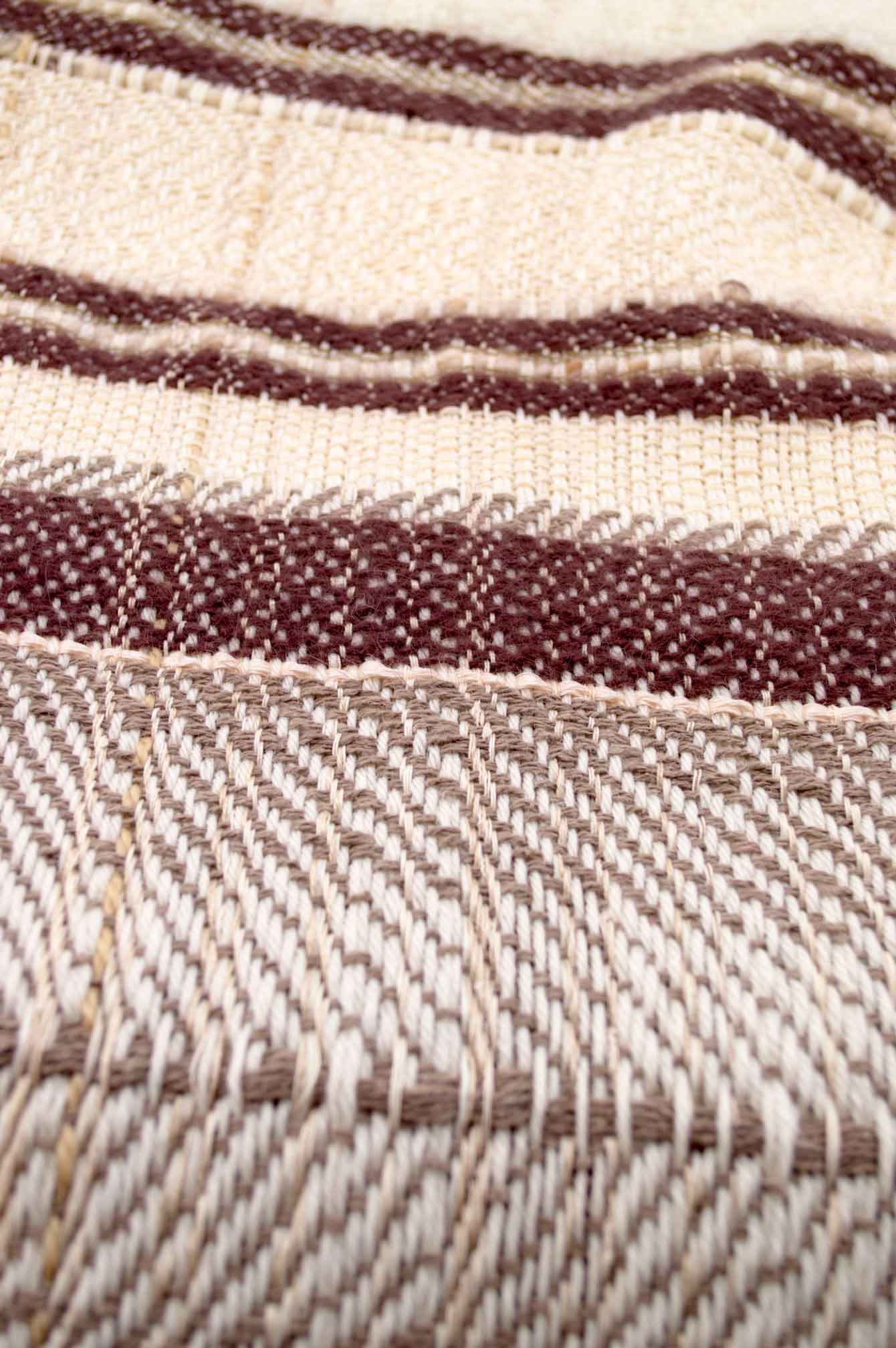 Throw blanket created with brown and taupe angora wood, pinky beige silk floss, silk, cashmere, country wool, ecru wool, and beige cotton threads slipped into the plaid.   Technique: Throw blanket hand-woven in a traditional way on non-mechanical looms in the 7th arrondissement of Paris in France.  Finishes: Right edge. Double stitching.  Size: 145 x 180 cm.  Single piece / 1 copy only.