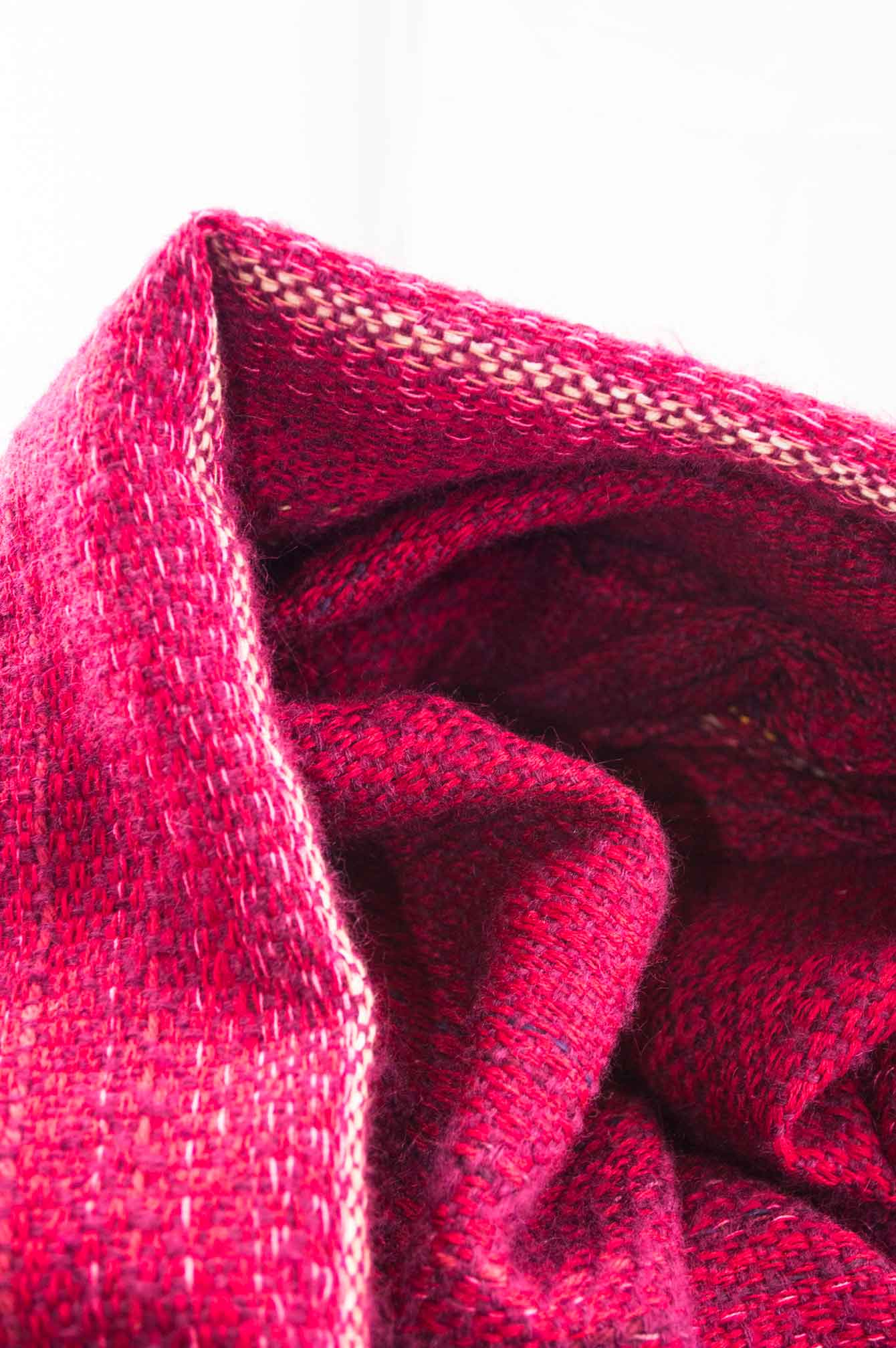 Throw blanket created with violet mohair, cashmere, wool, cotton, and linen.   Technique: Throw blanket hand-woven in a traditional way on non-mechanical looms in the 7th arrondissement of Paris in France.  Finishes: Right edge. Double stitching. 2 edges with 9 cm wool fringes.  Size: 150 x 235 cm.  Single piece / 1 copy only.