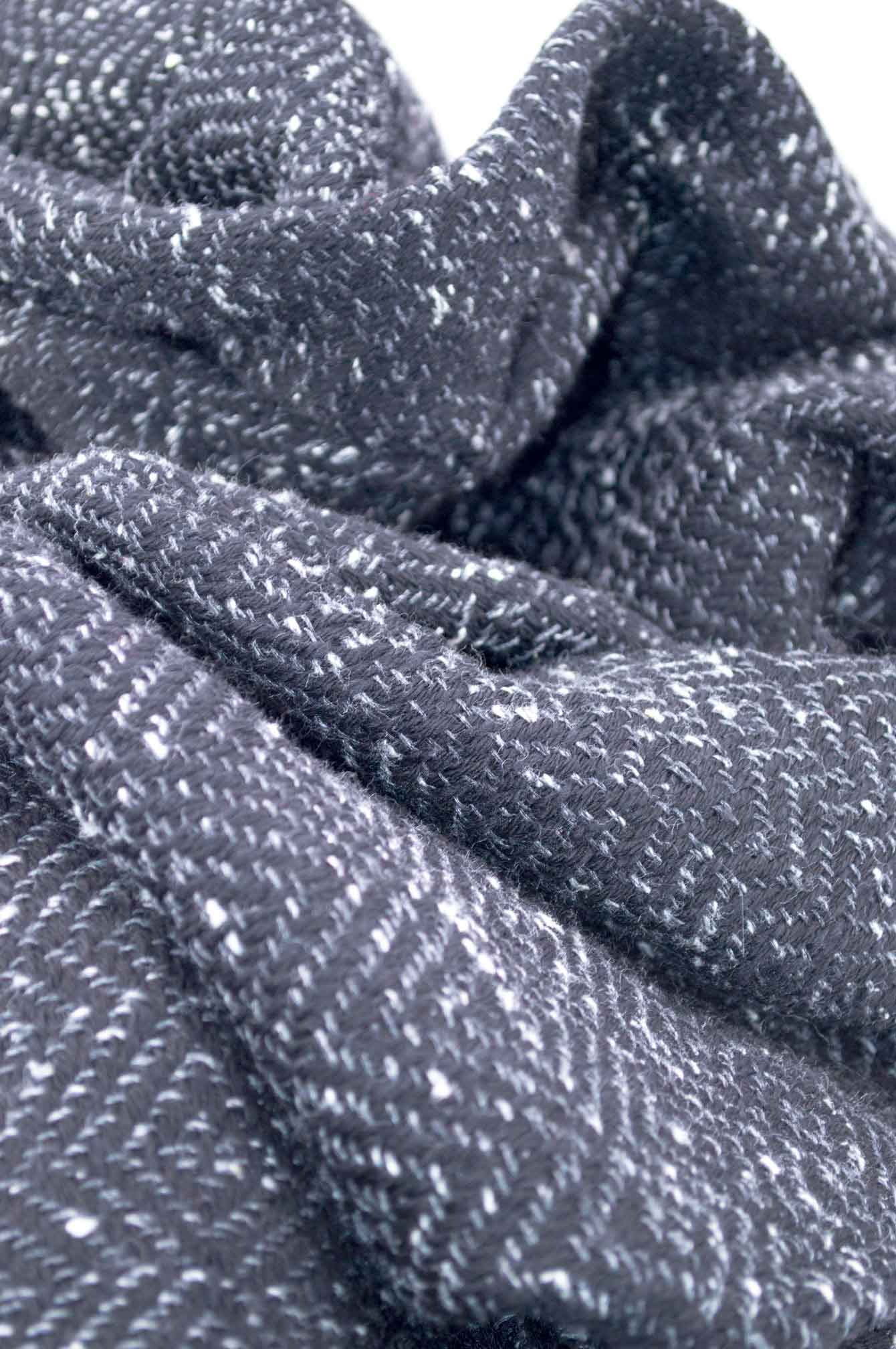 Throw blanketcreated with dark gray fleckedsilk floss,black wool.Succession of lozenge patterns.  Technique:Throw blanket hand-woven in a traditional way on non-mechanical looms in the 7th arrondissement of Paris in France.  Finishes: Right edge. Double stitching.4 pompons 11 cm long.  Size: 140 x 180 cm.  Single piece / 1 copy only.